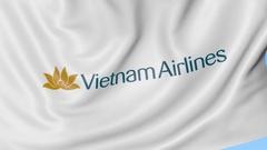 Waving flag of Vietnam Airlines against blue sky background, seamless loop Stock Footage