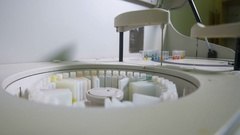 Robotic equipment puts Medical Samples on the Conveyor Line. Chemistry Stock Footage