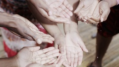 4K Hands of people from a poor community feel clean fresh water Stock Footage