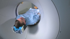 Patient is scanned by MRI, CT scanner. Magnetic resonance examination Stock Footage