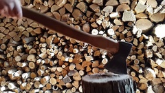 Preparing firewood,chopping wood with an ax. 60fps. Stock Footage