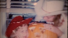 Young girls wear cowgirl outfits for Halloween, 4041 vintage film home movie Stock Footage