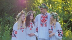 Group of young people in national costumes Slavic celebrate the summer solstice Stock Footage