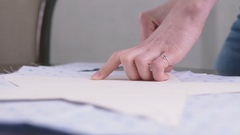 Close up footage of female hands drawing patterns on tissue with peace of chalk Stock Footage