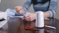 Close-up of woman's hand stitching quilting Stock Footage