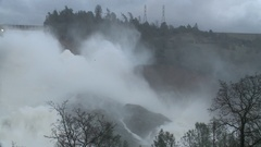 LAKE OROVILLE DAM CALIFORNIA EMERGENCY WATER RELEASE FLOOD DAMAGE Stock Footage