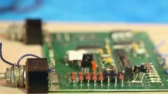 Technician diagnoses the circuit board components. Stock Footage
