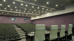 Panorama from Leather Chair to Microphone Table in Cinema Hall Stock Footage