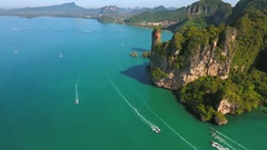 Thai Long Tail Boats with Tourists Sailing near Big Mountain. Railey beach Stock Footage