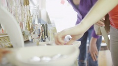 4K Female friends shopping for jewelry in small boutique shop Stock Footage