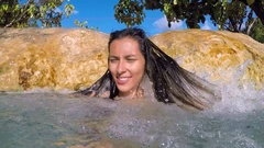Young Woman Smiling Under Waterfall at Emerald Pool Pond with Blue Water. Slow Stock Footage