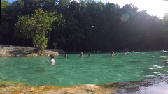 Athletic Young Man Jumping Into Emerald Pool Pond with Blue Water. Slow Motion Stock Footage