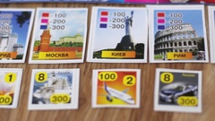 The game monopoly closeup with chips and dices Stock Footage