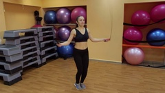 Young slim woman jumping with skipping rope in gym. Stock Footage