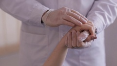 Doctor comforting patient. The doctor's hand stroking the patient and comforts Stock Footage