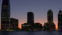 CLOSE UP: Magical Jersey City skyline lit up with lights seen from Hudson River Stock Footage