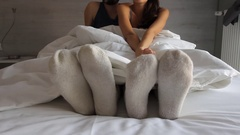 Boy's feet moving on the bed Stock Footage