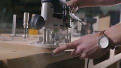Young man working as carpenter and cutting board, slow motion Stock Footage