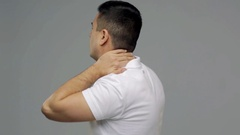 Unhappy man suffering from neck pain Arkistovideo