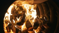 Crest of flame on burning wood in fireplace, slow motion Stock Footage