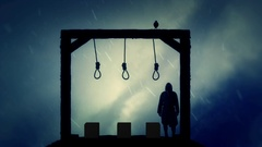 Executioner Standing in the Gallows Under Rain Stock Footage