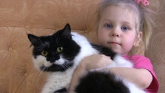 A Little Girl Is Hugging Her Pet Cat And Smiling. The Cat Is Happy, Too Arkistovideo