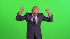 Extremely happy businessman goofs around while walking towards camera. Stock Footage