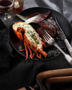 Lobster and steak, surf and turf, close-up Stock Photos