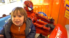 Child in panic attack when riding with Spiderman Stock Footage