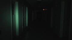 A night-vision camera catches a ghost walking the halls of an abandoned Stock Footage