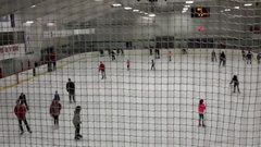 People skating in indoor sports complex center Stock Footage