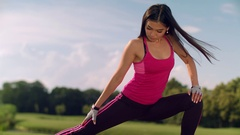 Asian woman stretching legs outdoor. Fitness woman doing stretching exercise Stock Footage