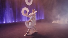 Circus performer juggling with three big white rings, Moscow, Russia Stock Footage