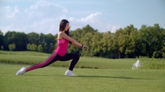 Woman doing legs stretching exercise outdoors. Asian woman stretching legs Arkistovideo