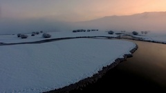 Flying though and over fog during colorful winter sunrise Stock Footage