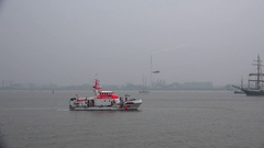 4k Coastguard demonstration with helicopter and lifeboat in Bremerhaven harbor Stock Footage