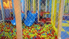 Children in plastic ball pool play area Stock Footage