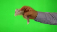 Hand holding dollars in a giving gesture Stock Footage