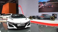 Honda NSX hybrid and McLaren-Honda MP4-31 Formula 1 race car Stock Footage