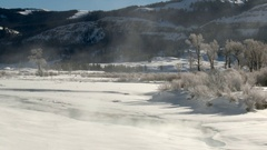 Snowscape with steam coming from river in the Lamar valley, Yellowstone N.P. Stock Footage