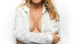 Topless woman body in white shirt covering her big breast Stock Photos