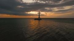 Catholic cross in the sea Stock Footage