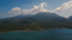 Aerial view beautiful coastline on the tropical island with volcanic sand beach Stock Footage