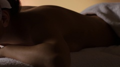 Girl resting after a massage in the dim light. Studio Stock Footage