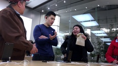 People asking questions about iphone inside Apple store Stock Footage