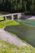 Heart symbol from stones in Livigno Lake, Alps Mountains, Italy Stock Photos