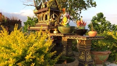 Small Buddist House of Spirits with Alms to the Gods. Phuket, Thailand. HD Stock Footage