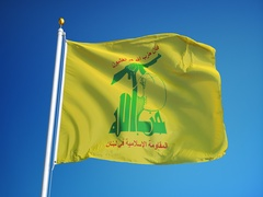 Hezbollah political party flag in slow motion Stock Footage