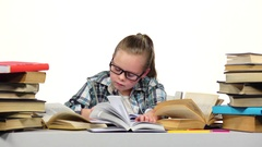 Girl carefully read and write data to the notebook. White background Stock Footage