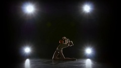 Gymnast with the ball in his hands doing acrobatic moves. Black background Stock Footage